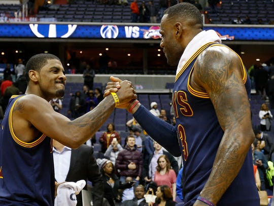 Cleveland Cavaliers guard Kyrie Irving celebrates with
