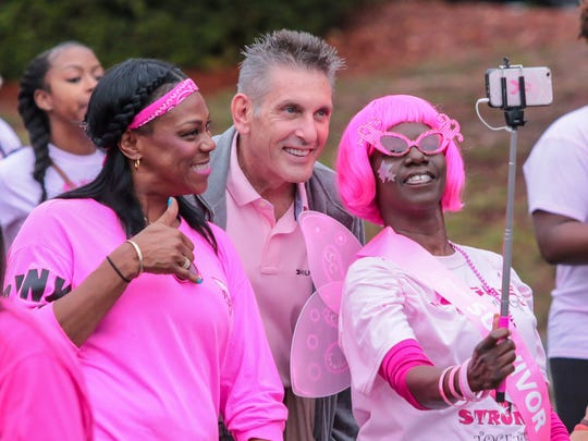 People smile and take a quick selfie during Pensacola's 15th annual Making Strides Against Breast Cancer 5K walk on Saturday, October 28, 2017.