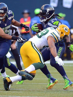 Green Bay Packers linebacker Brad Jones (59) misses a tackle on Marshawn Lynch during last week's game against the Seattle Seahawks at CenturyLink Field in Seattle.
