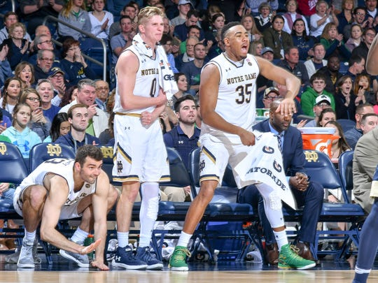 Notre Dame forward John Mooney (33), guard Rex Pflueger (0) and forward Bonzie Colson (35) react in the second half against Pittsburgh at Purcell Pavilion.