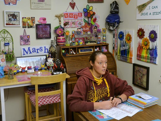 There are few open spaces on the walls in Marsha Hagfors' St. Cloud apartment because of the many pieces of art hanging there with positive messages throughout. The artwork and photography there is a form of therapy for Hagfors, who suffers from bipolar disorder. The most common word is 'believe' to remind her to believe in herself.