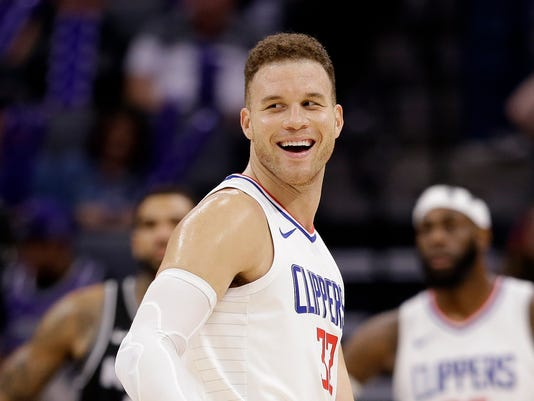 FILE - In this Jan. 11, 2018, file photo, Los Angeles Clippers forward Blake Griffin smiles during the second half of an NBA basketball game against the Sacramento Kings in Sacramento, Calif. The Detroit Pistons dramatically shook their struggling roster by acquiring one of the NBA's top players in Griffin in a trade with the Clippers. The deal for the five-time All-Star forward was announced early Tuesday, Jan. 30, 2018, giving Detroit a player who has been the face of the Clippers but whose career has been undercut by injuries.  (AP Photo/Rich Pedroncelli, File)