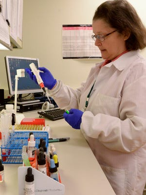 Marilyn Starzewski, blood bank core specialist, performs antigen testing on red blood cells to find compatible blood for a patient who needs a blood transfusion at Holy Family Memorial in Manitowoc.
