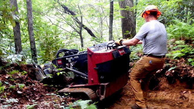 Tom Thomas, Backcountry Horsemen member, uses a trail machine to clear debris off a trail. The group will be one of many volunteering at Pisgah Pride Day May 5 in Pisgah National Forest
