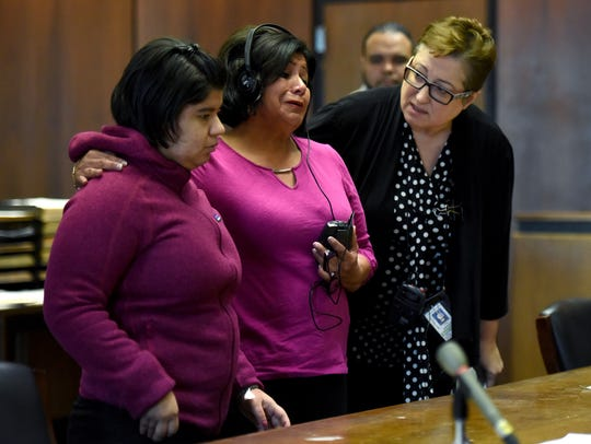 Carmen Quinto, the mother of murder victim Diana Boggio, center, with Boggio's daughter, Arlett, left, shares the impact of her daughter's death on Arlett, who is autistic during admitted killer Pedro Lora Pena's sentencing at Superior Court in Newark on Monday, March 5, 2018.