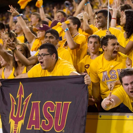 ASU fans gets excited before the start of an ASU game against Weber State at Sun Devil Stadium in Tempe on August 28, 2014.