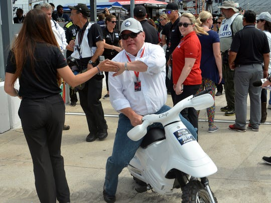 Chip Ganassi greets a person on pit road before a 2017