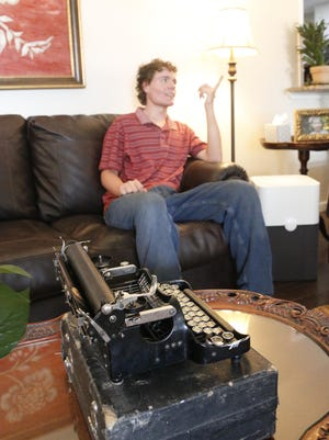 Mo Goff is pictured in the living room of the south Brownwood home where he lives with his parents and sister. The typewriter in the foreground is a 1921-model Corona and is the type once used by Ernest Hemingway.