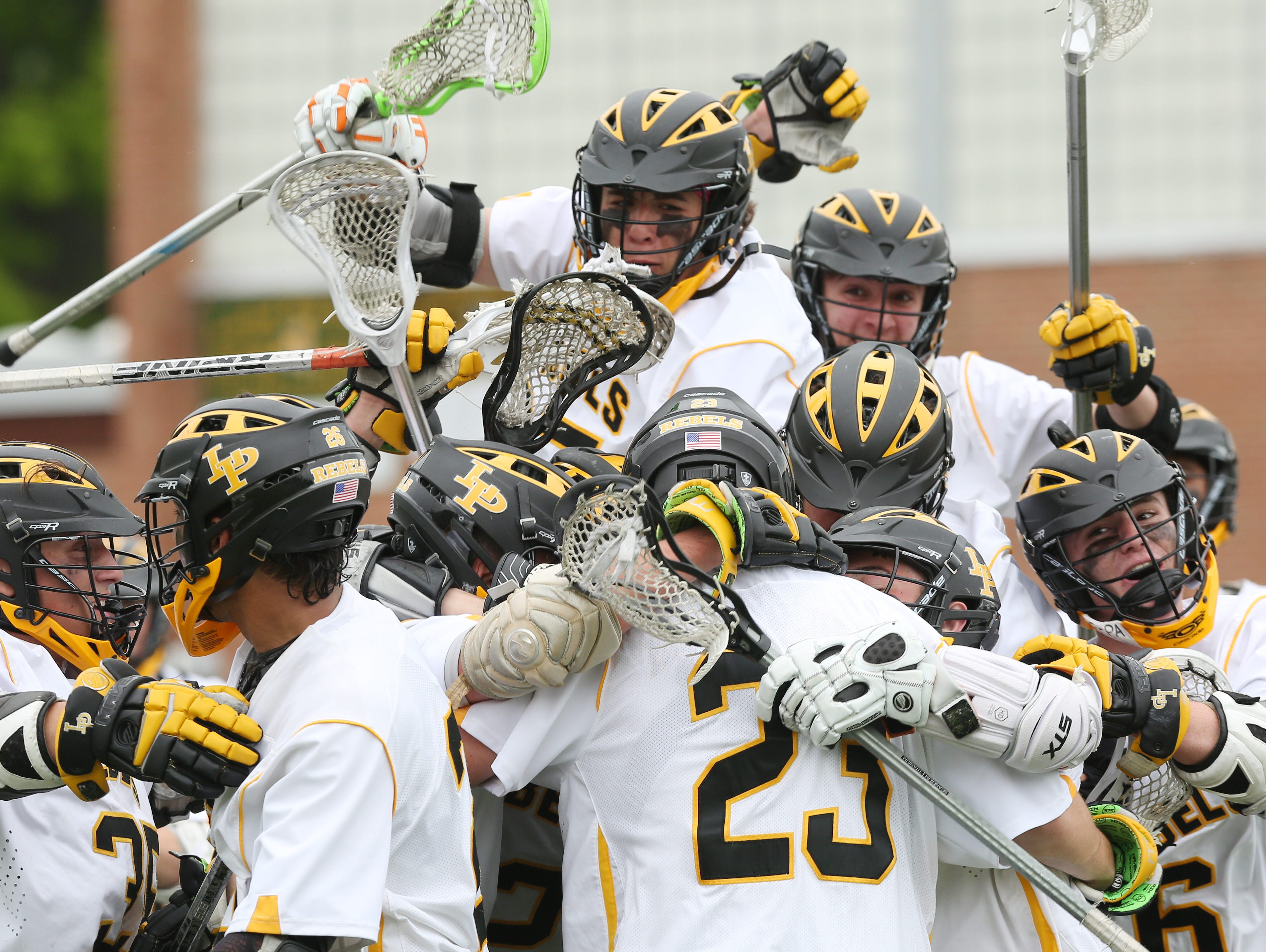 Lakeland/Panas players celebrate their 11-7 victory over Scarsdale in a Section 1 boys lacrosse playoff game at Lakeland High School in Shrub Oak May 21, 2016.