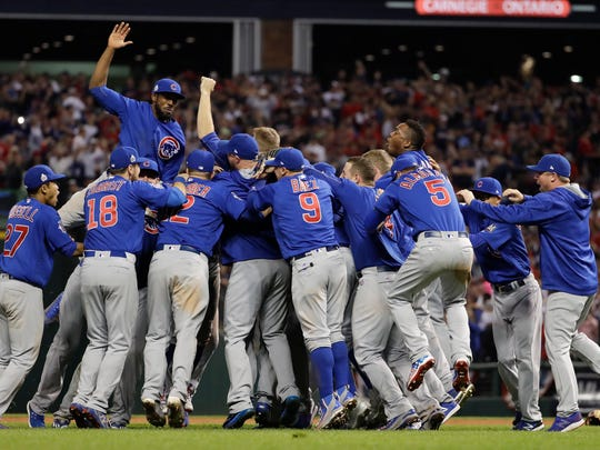 Chicago Cubs celebrate after Game 7 of the Major League