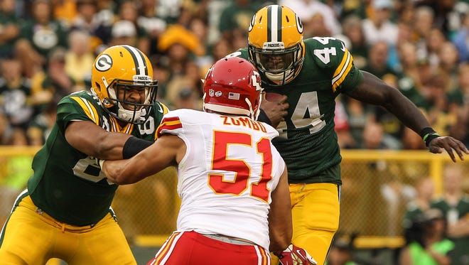 Richard Rodgers blocks Frank Zombo as James Starks carries the ball during a preseason game at Lambeau Field.
