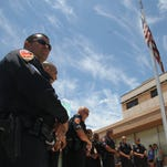 Carlsbad police officers observed a moment of silence for the victims of Thursday's attack in Dallas that killed five.