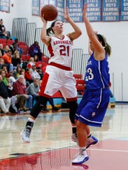 Arrowhead senior Grace Gilmore (21) elevates for a