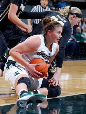Michigan State's Jenna Allen and Purdue's Bree Horrocks, rear, battle for the ball Wednesday, Jan. 27, 2016, in East Lansing, Mich.