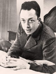 Nobel Prize-winning author Albert Camus pauses for