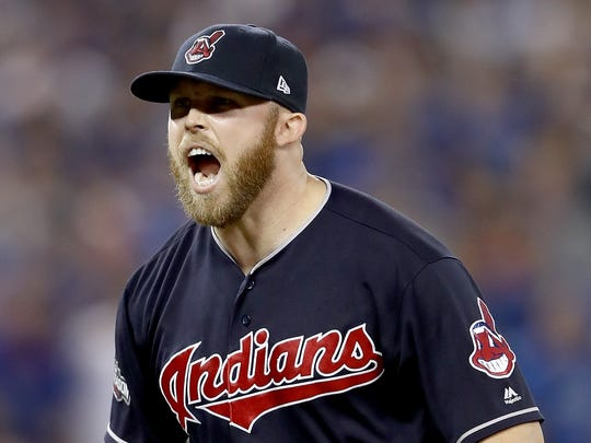 Cody Allen of the Cleveland Indians celebrates after defeating the Toronto Blue Jays in Game 5 of the American League Championship Series in Toronto, Canada, in 2016. Chief Wahoo appears on the player's cap and the sleeve of his uniform.