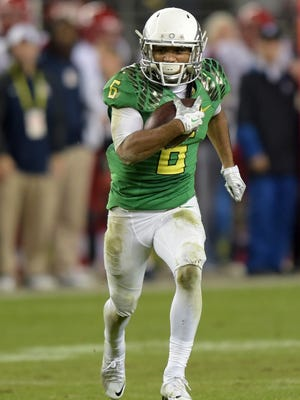 Oregon Ducks receiver Charles Nelson (6) carries the ball on a 73-yard reception in the second quarter against the Arizona Wildcats in the Pac-12 Championship at Levi's Stadium.
