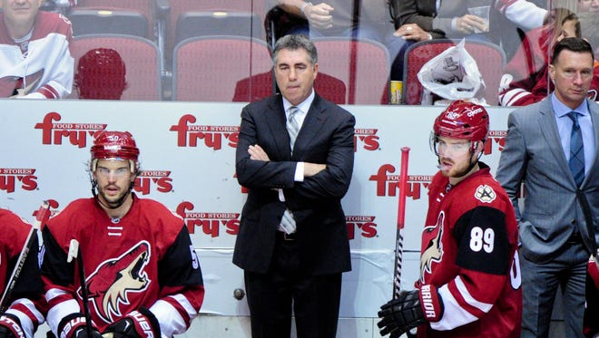Arizona Coyotes head coach Dave Tippett looks on during the third period against the Edmonton Oilers at Gila River Arena on Nov. 12, 2015.