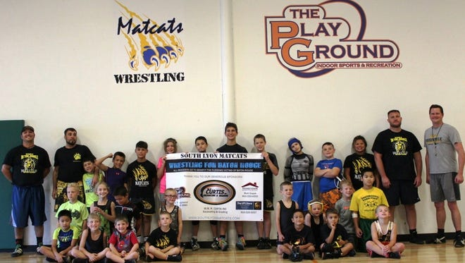 The South Lyon Matcats and Toledo Attack youth wrestling clubs raised money for Louisiana flood victims.