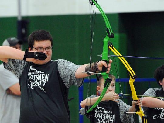 Samuel Conacher lets his arrow fly toward the target