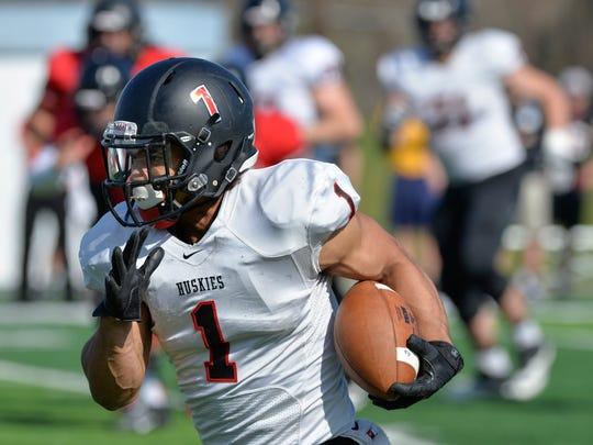 St. Cloud State wide receiver Jaden Huff (1) runs the