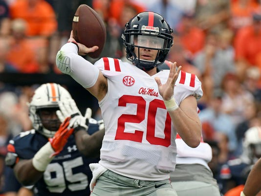FIE - In this Oct. 7, 2017, file photo, Mississippi quarterback Shea Patterson (20) throws a pass during the first half of an NCAA college football game against Auburn in Auburn, Ala. Patterson was supposed to be an elite quarterback recruit when he came to campus and so far, he hasn't disappointed. The sophomore leads the SEC in yards passing while helping hold together a program that's faced plenty of adversity. (AP Photo/Thomas Graning, File)