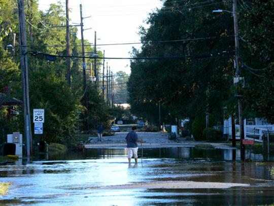 A resident walks through flooded streets of Savannah,