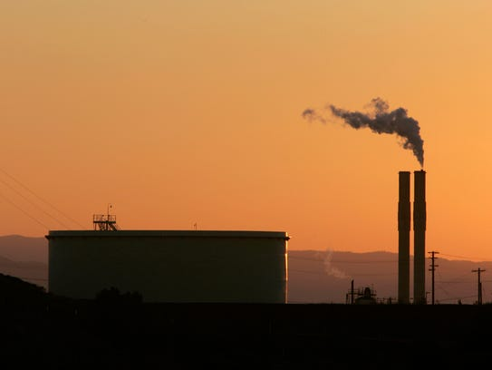In this Friday Sept. 22, 2006, file photo, an oil refinery is seen at sunset in Rodeo, California.