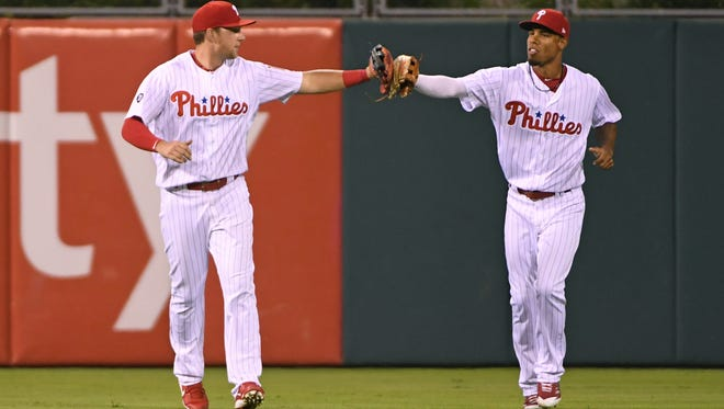 Philadelphia Phillies left fielder Rhys Hoskins celebrates with right fielder Nick Williams after final out during the ninth inning against Miami Marlins Aug. 23 at Citizens Bank Park.