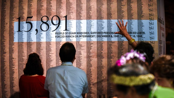 "Guests search through names of Guam residents, killed or affected during the World War II occupation of Japanese Imperial forces, as they tour the new permanent exhibit entitled, ""I Hinanao-ta Nu I Manaotao Tåno' - I CHamoru Siha"" or ""The Journey of the CHamoru People"" at the Sen. Antonio M. Palomo Guam Museum & Educational Facility in Hagåtña on Thursday, May 3, 2018."