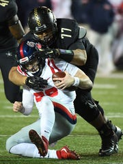 Ole Miss quarterback Shea Patterson (20) is tackled
