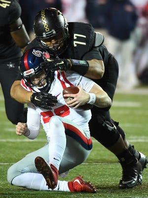 Ole Miss quarterback Shea Patterson (20) is tackled by Vanderbilt defensive tackle Nifae Lealao (77) on Nov. 19, 2016.