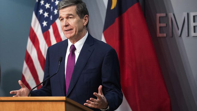 Gov. Roy Cooper speaks during a briefing on North Carolina's coronavirus pandemic response April 13 at the N.C. Emergency Operations Center in Raleigh.