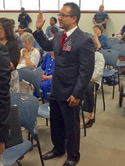 St. George resident Dave Araque takes the oath of allegiance June 26 at a naturalization ceremony in Salt Lake City.