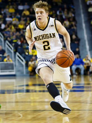 Michigan graduate transfer Spike Albrecht (2) will make his first official visit since being granted a transfer release to Purdue on Wednesday, according to his father, Chuck.