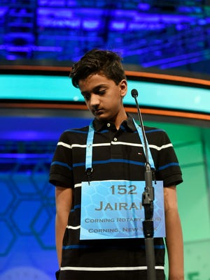"""Jairam Hathwar, 13, of Painted Post, correctly spells """"triglycerides"""" during the 2016 Scripps National Spelling Bee at the Gaylord National Resort and Convention Center."""