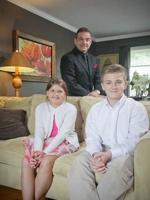 Tony Vanetti, with his kids Maggie and John, at their home in Louisville, KY. June 3, 2016