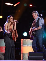 "Spensha Baker performing with Blake Shelton on the season finale of ""The Voice."""