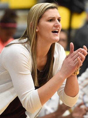 Cape's Head Coach Lauren Carra cheers on her team as Cape Henlopen HS (white) hosted Indian River HS (green) in girls varsity basketball at the school near Lewes on Tuesday, Jan. 12.