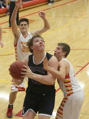 Norwalk sophomore Tyler Endres gets a look at the basket