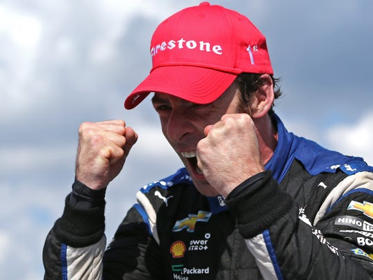 Indy Car Series driver Simon Pagenaud celebrates winning the Honda Indy 200 at Mid-Ohio Sports Car Course.