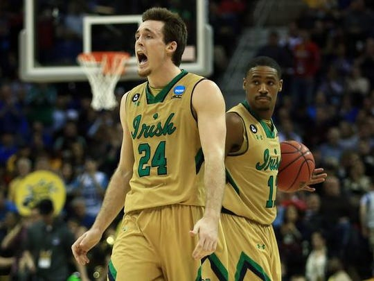 Notre Dame Fighting Irish guard/forward Pat Connaughton (24) reacts after the game against the Wichita State Shockers in the semifinals of the Midwest Regional of the 2015 NCAA Tournament at Quicken Loans Arena. Notre Dame won 81-70.