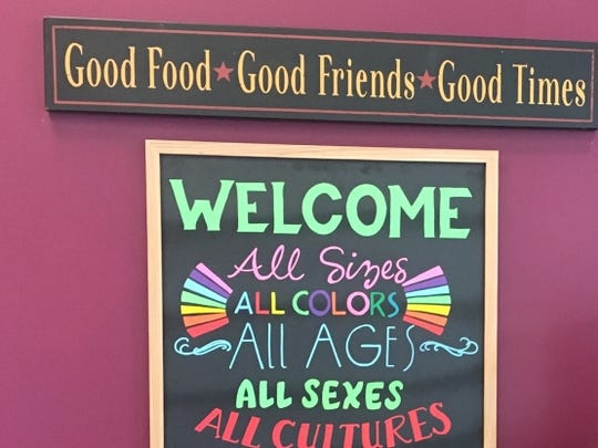 The welcome sign at Yassin's Falafel House is becoming