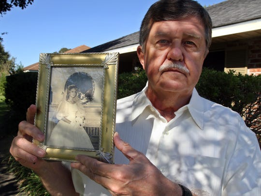 Will Horton holds a photograph of his sister, Mary,