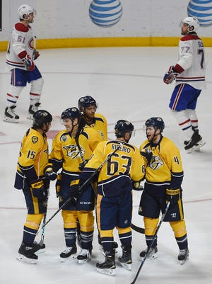 The Predators celebrate after scoring their third goal against the Canadiens.