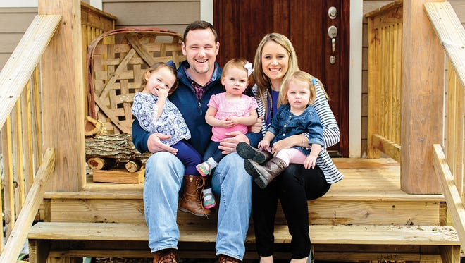 Whitney and Zack Moore are pictured with daughters Ellie Kate, Addie and Mollie Reese.