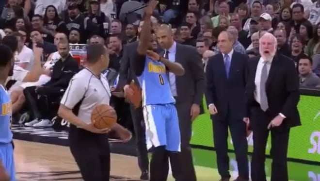 Emmanuel Mudiay signals for Gregg Popovich to be ejected.