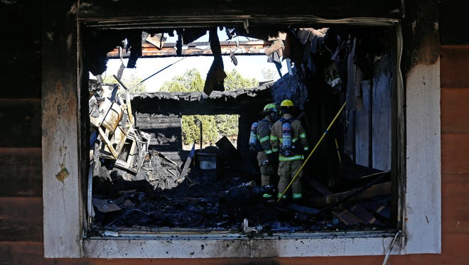 The San Juan County Fire Department responds on Monday to a fire on County Road 2396 north of Aztec.