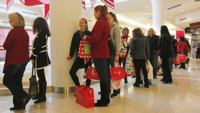 Shoppers wait in line at Kenwood Towne Centre on Black Friday last year.