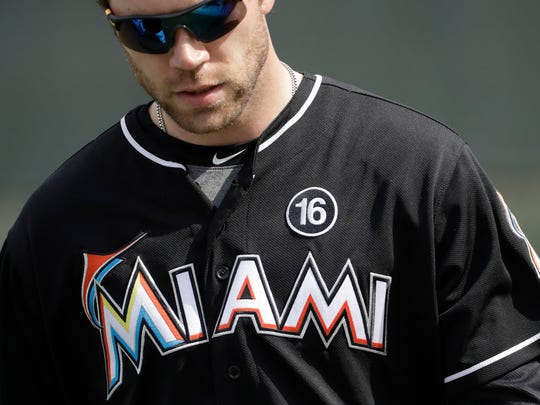 Miami Marlins pitcher David Phelps stretches during a spring training baseball workout Tuesday, Feb. 14, 2017, in Jupiter, Fla. The Marlins are wearing number 16 on their uniform to honor pitcher Jose Fernandez who died last year. (AP Photo/David J. Phillip)